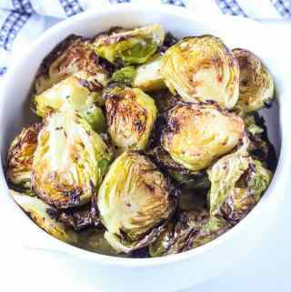 Lemon Brussels sprouts are in a white bowl