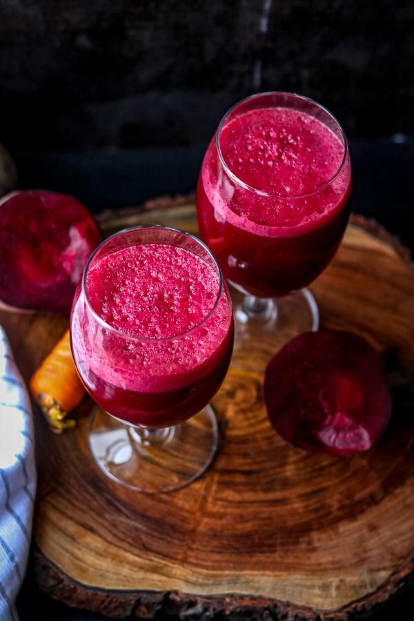 Beet Carrots Apple Juice Recipe in two glasses on wooden board