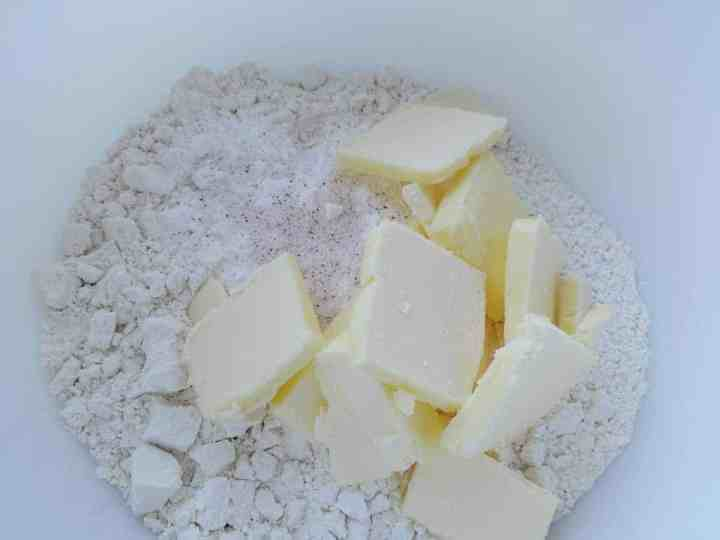 Butter in bowl with flour and salt - making biscuits