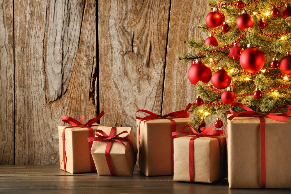 Christmas gift on grunge wood background