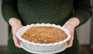 holding apple crumble pie