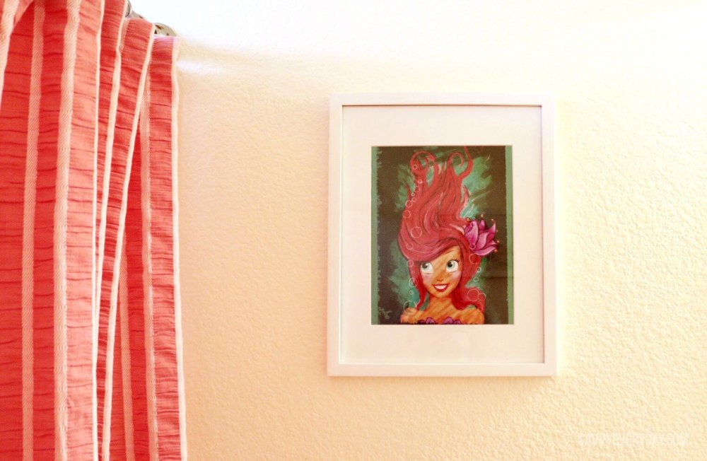 coral shower curtain and little mermaid picture