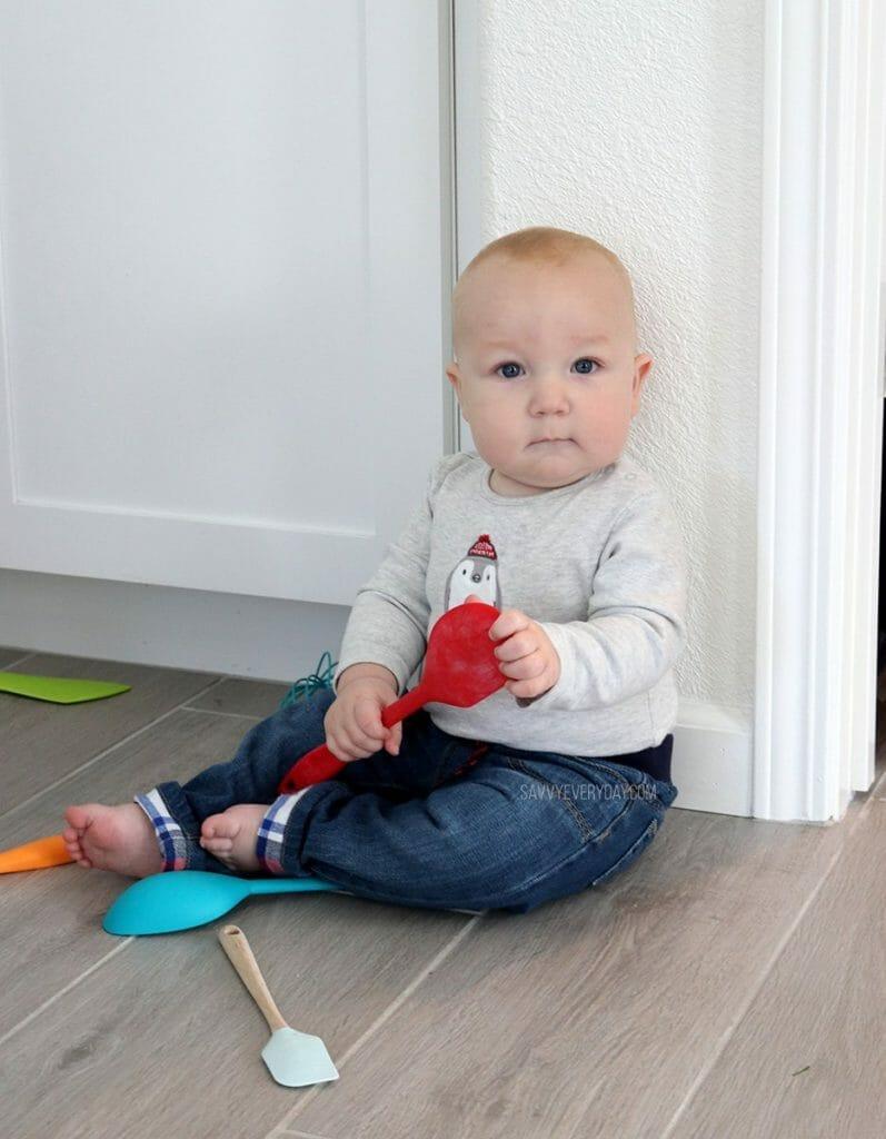 baby holding spatula