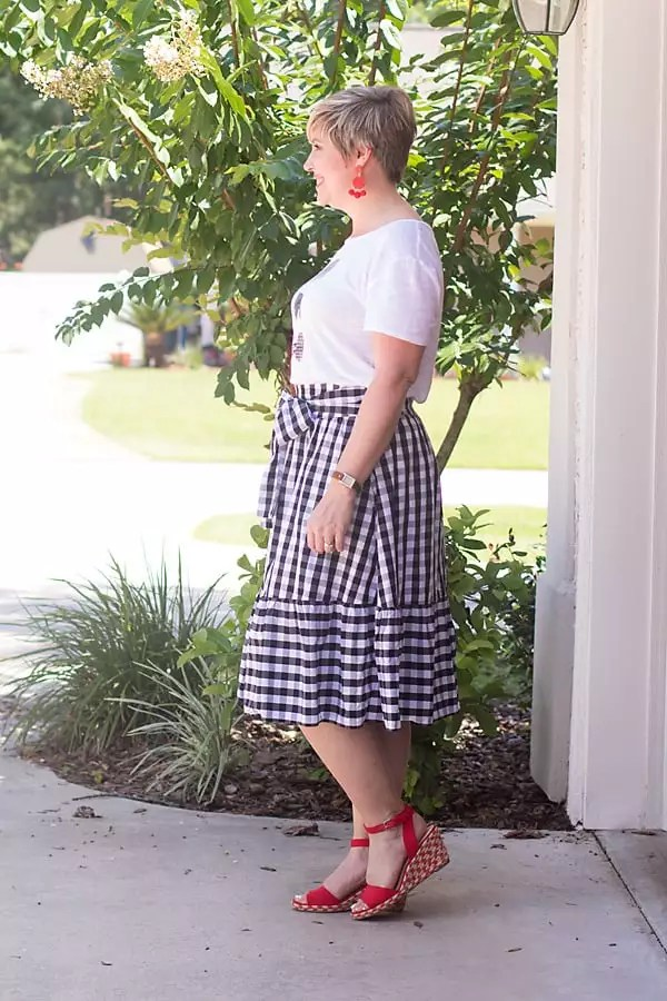 gingham skirt, red statement earrings, bright sandals, gingham