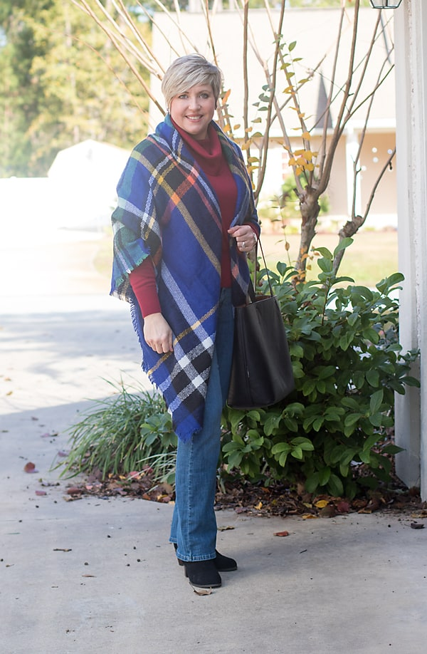 Blanket scarf as poncho with cowl neck sweater and boot cut jeans