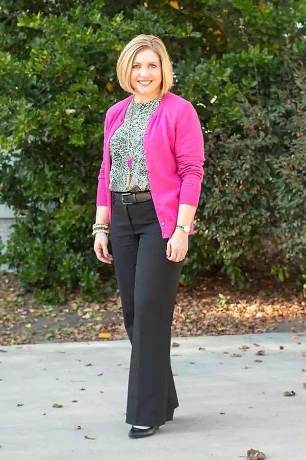 Hot pink cardigan with print blouse and black slacks