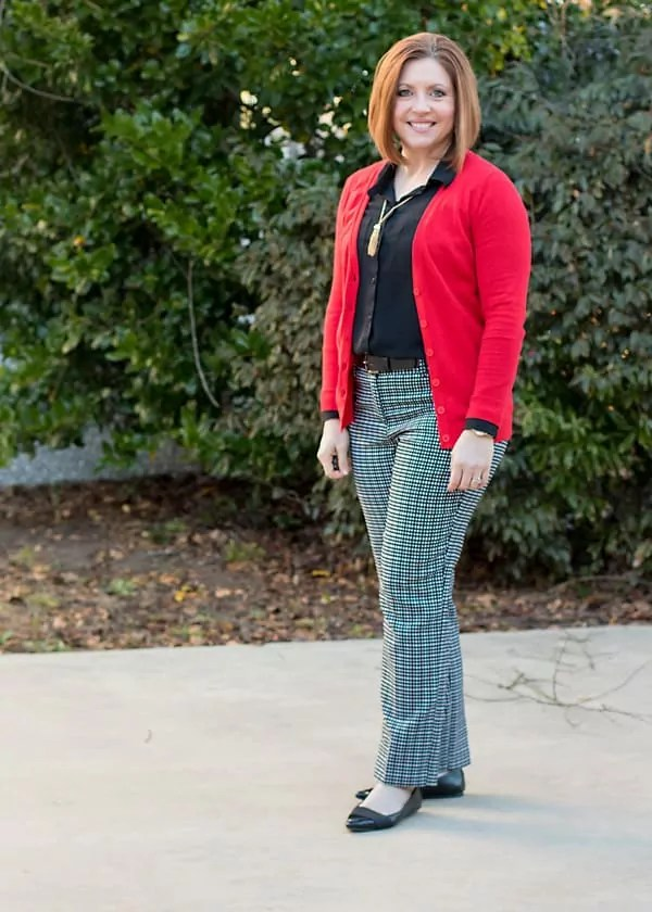 Black top with black and white pants and red cardigan