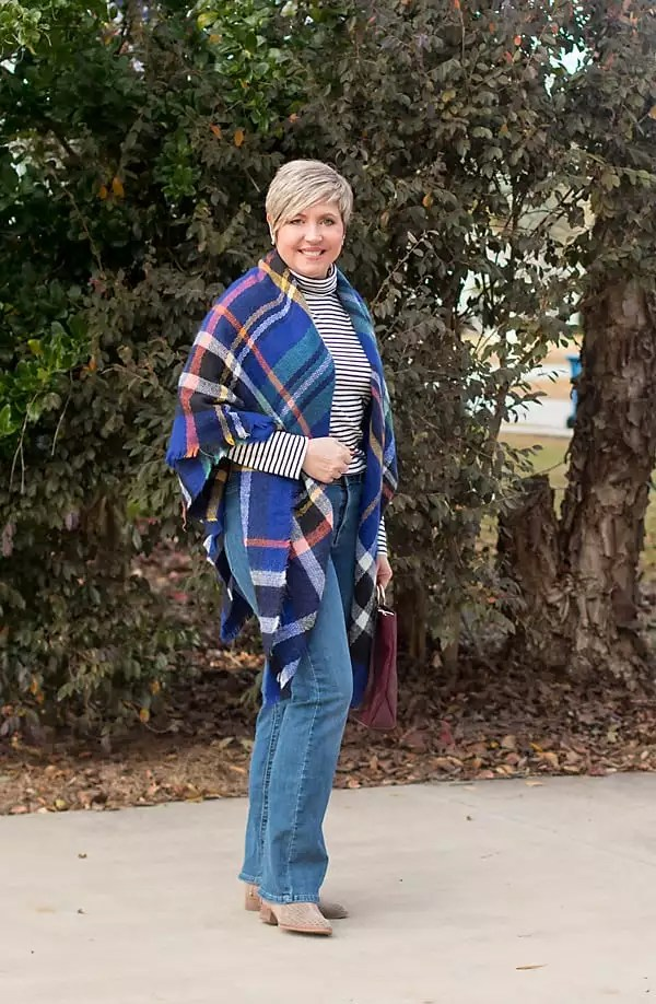 Blanket scarf as poncho with striped turtleneck and boot cut jeans