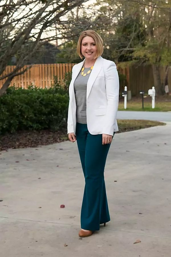 Business outfit with bright necklace to draw the eye up and away from wide hips.