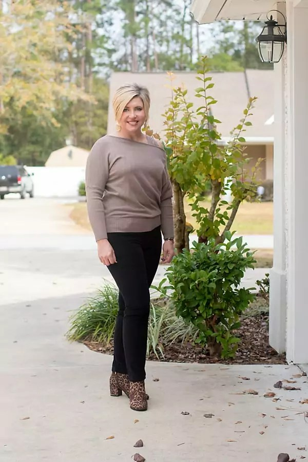 off shoulder top with velvet pants and leopard booties holiday outfit