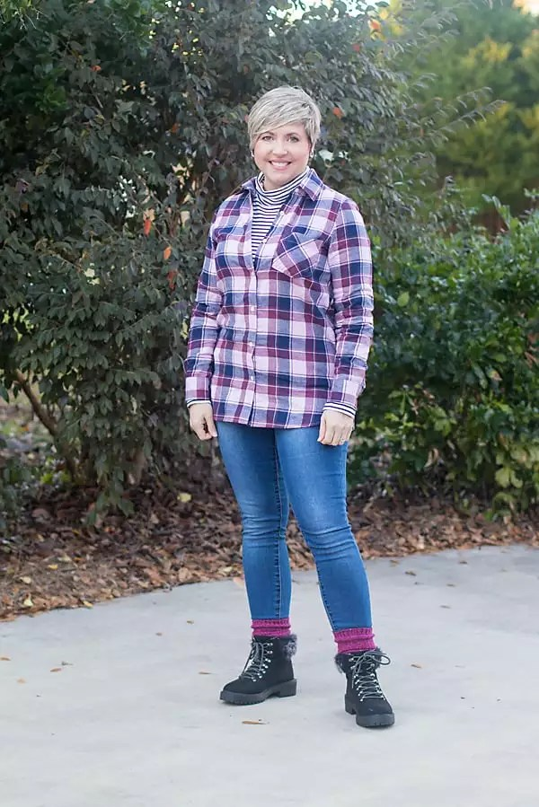 casual weekend outfit with plaid shirt and winter boots