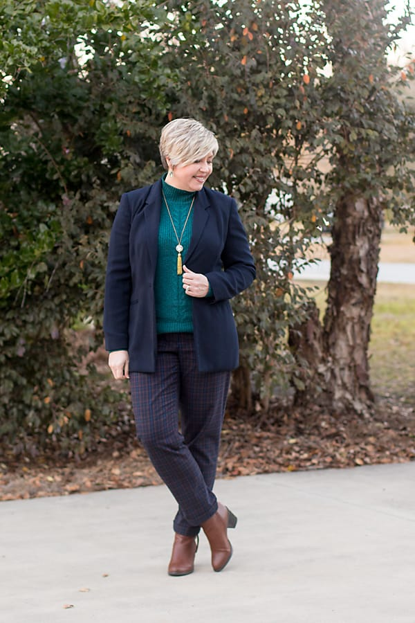 women's winter office outfit with plaid pants, sweater, and ankle boots