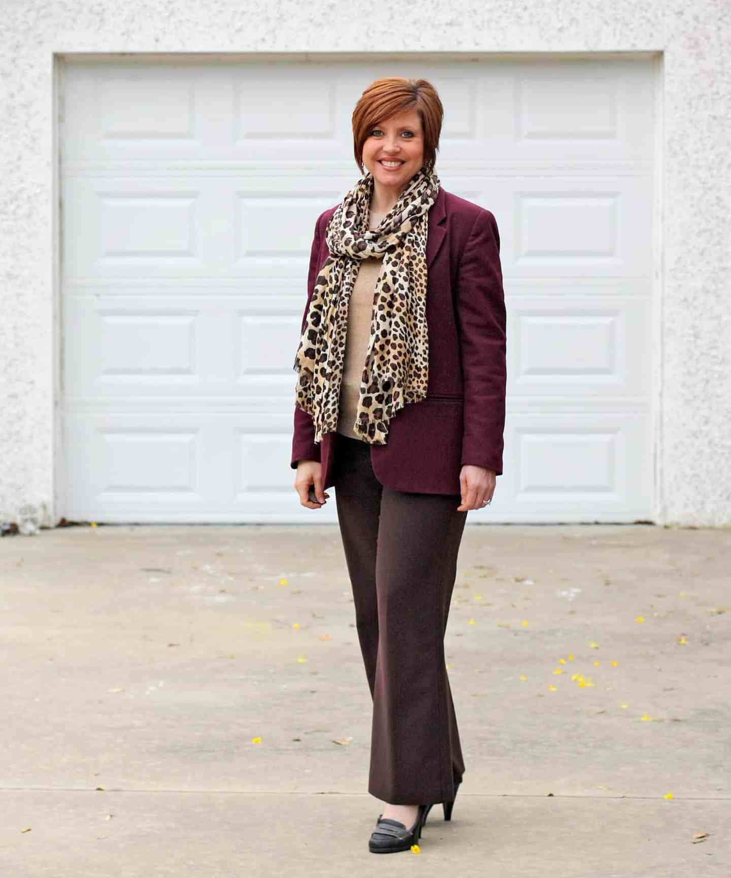 womens office outfit with burgundy blazer, brown pants, and leopard scarf