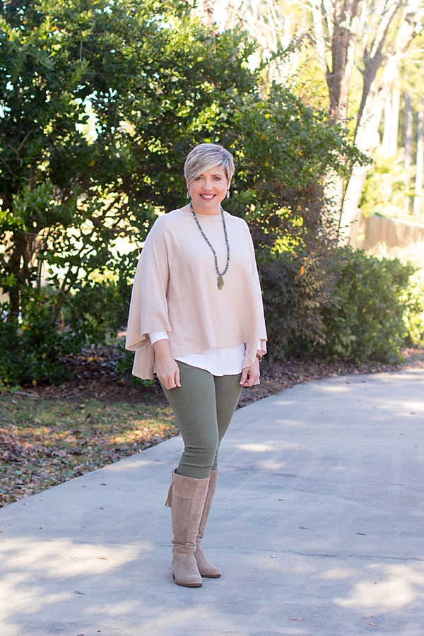 winter poncho outfit with tall taupe boots