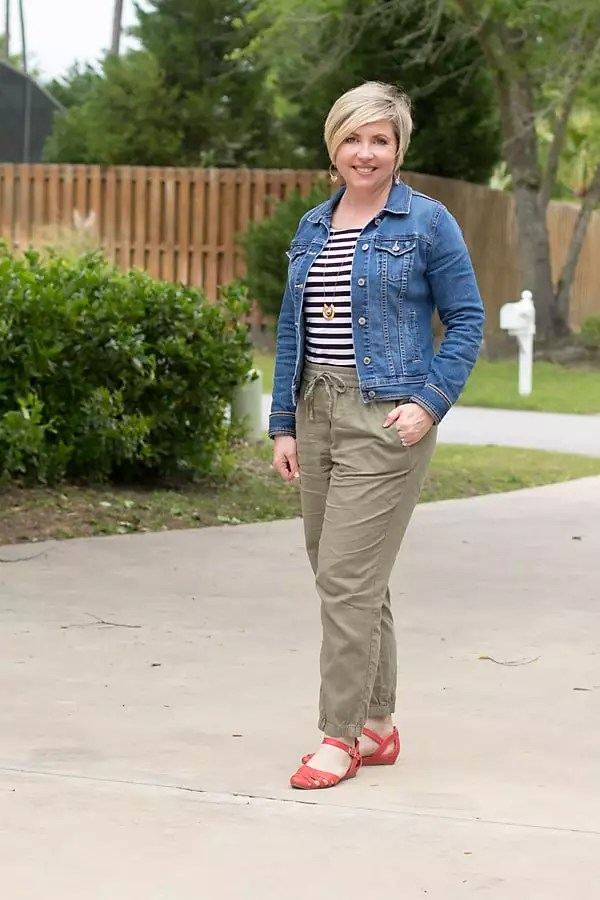 denim jacket for spring with linen joggers and bright shoes