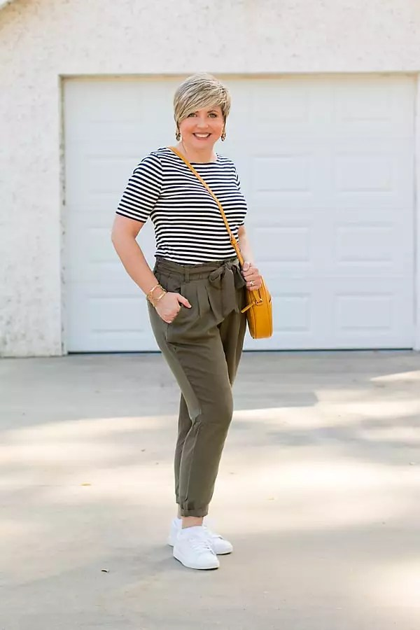 striped top and sneakers with paper bag waist pants