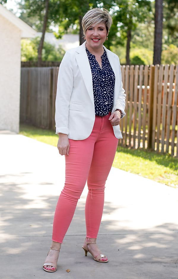 white blazer with coral jeans