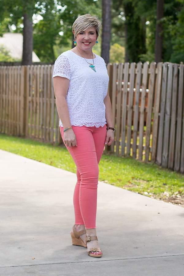fashion blogger in coral jeans