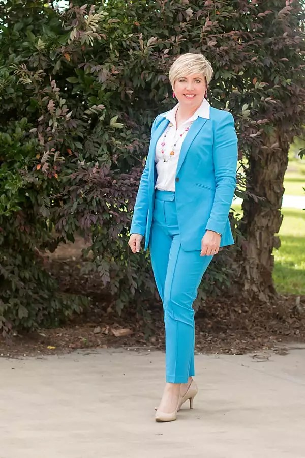 bright suit with white button up