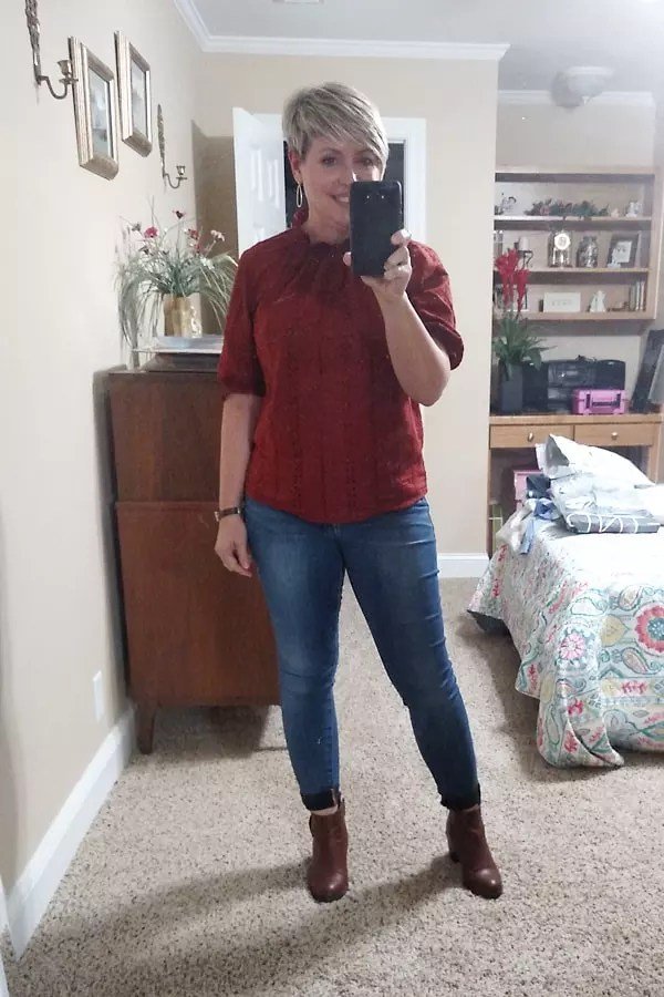 Rust top with jeans and booties