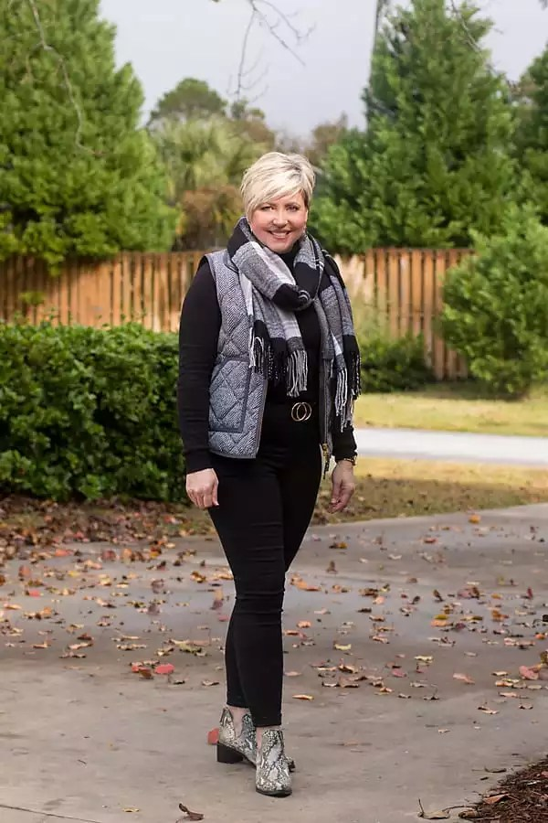 herringbone vest and snakeskin boots with black jeans outfit