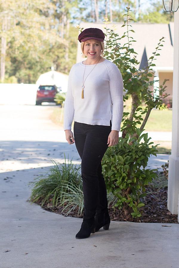 cream sweater and velvet pants