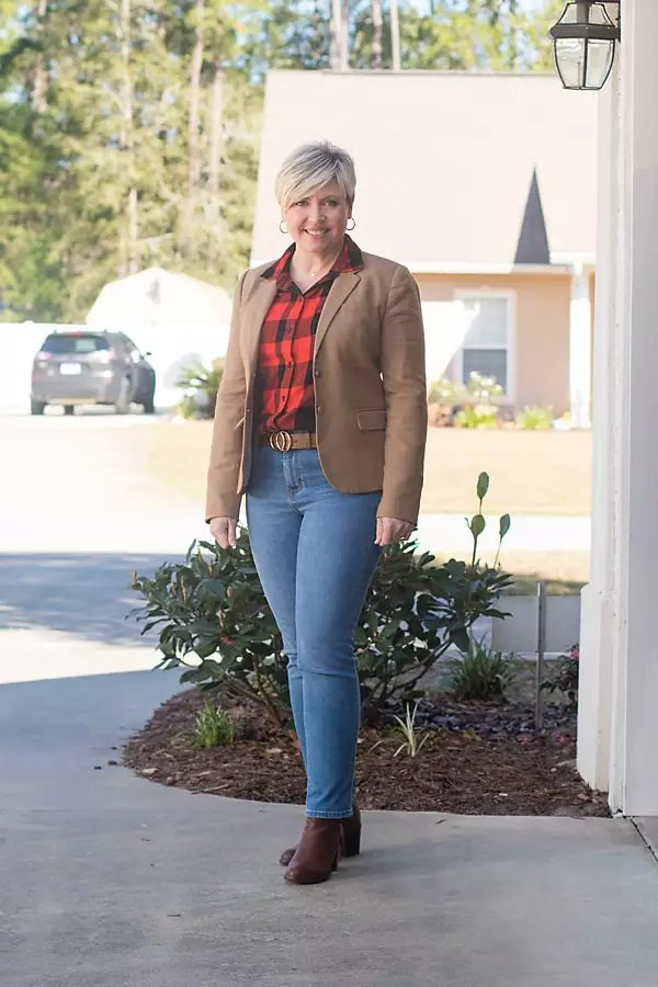 camel blazer with plaid shirt and jeans