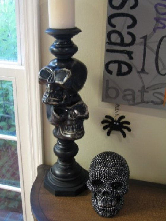 DIY skull candlesticks. Make this Halloween Decorations for only $5!
