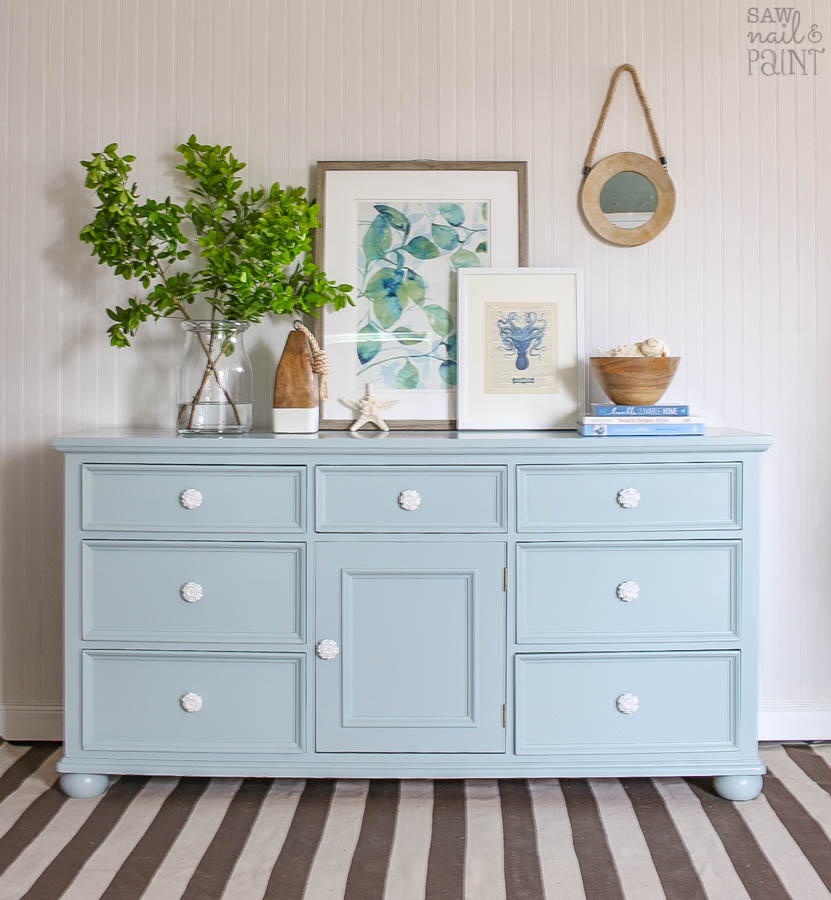 persian blue and snow white painted dresser with white knobs saw