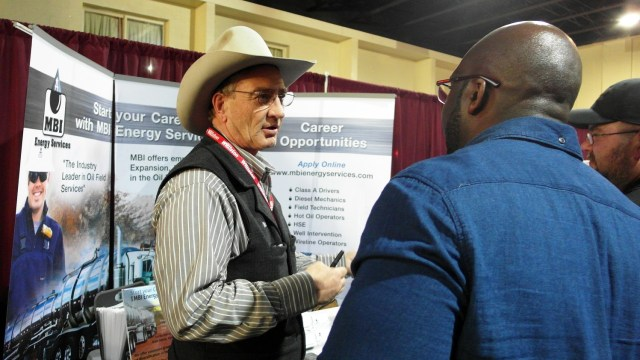 Monte Horst, recruiter for MBI Energy Services, talks to job-seekers Wednesday, March 11, 2015, at a job fair in Williston, N.D. Amy Dalrymple/Forum News Service