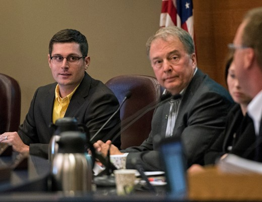 Fargo, N.D., City Commissioner Tony Gehrig listens to Commissioner Dave Piepkorn speak about Gehrig's plan to cut the city's property taxes by 20-percent during a city commissioner's meeting at the Civic Center on Monday, July 20, 2015. Nick Wagner / The Forum