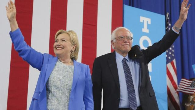 Democratic U.S.  presidential candidate Hillary Clinton and Sen. Bernie Sanders stand together during a campaign rally where Sanders endorsed Clinton in Portsmouth, New Hampshire, U.S., July 12, 2016.  REUTERS/Brian Snyder  - TPX IMAGES OF THE DAY