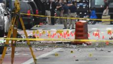 Evidence markers on the street surround police and Federal Bureau of Investigation (FBI) officials near the site of an explosion in the Chelsea neighborhood of Manhattan, New York, U.S.  September 18, 2016.  REUTERS/Rashid Umar Abbasi