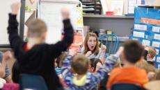 Wilder Elementary kindergarten teacher Cassie Riewer and her students share some enthusiam Monday. photo by Eric Hylden/Grand Forks Herald