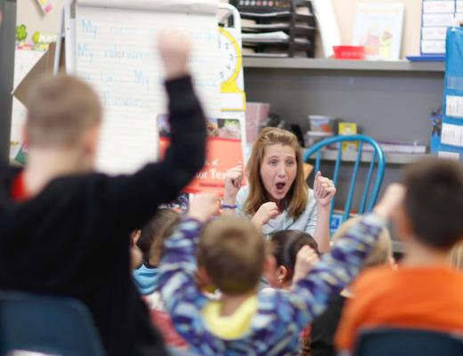 Wilder Elementary kindergarten teacher Cassie Riewer and her students share some enthusiam Monday. photo by Eric Hylden/Grand Forks Herald