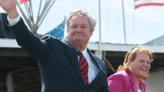 North Dakota Governor Jack Dalrymple waves to the crowd as he is recognized during the Cannon Ball Flag Day Celebration, along with Senator Heidi Heitkamp, Senator John Hoeven and Congressman Kevin Cramer. (Kevin Cederstrom/Forum News Service)