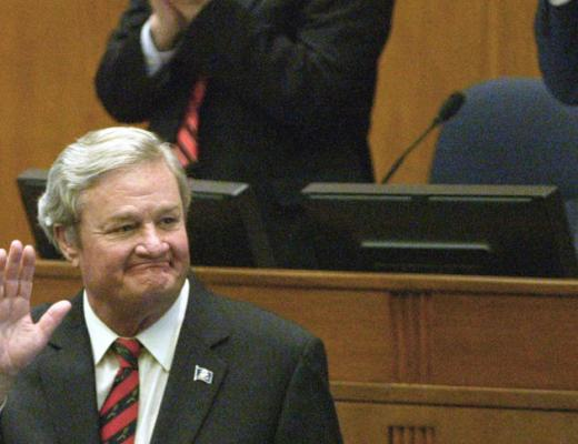 MIKE McCLEARY/Bismarck Tribune Governor Jack Dalrymple aknowledges the applause after he delivered his Budget Address to members of the North Dakota legislators and the public in the House chamber Wednesday morning 12-3-2014 at the state Capitol in Bismarck. Behind Dalrymple is Speaker of the House Wes Belter, left, and Lt. Governor Drew Wrigley.