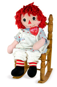 old rag doll with heart lollipop