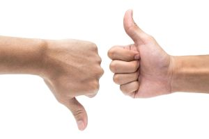 gestures of thumbs up or thumbs down