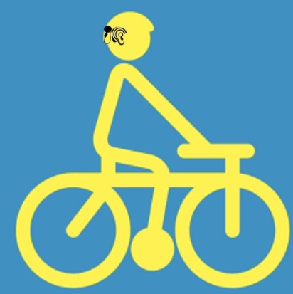 Screen Shot of a road sign with someone riding a bike while wearing a cochlear implant