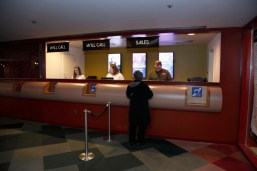 This picture, taken from the Let's Loop Seattle site, shows signage at the ticket counter indicating the presence of the hearing loop at the Seattle Repertory Theater