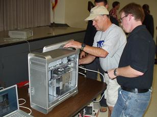 Mike Bishop (left) and Herb Wright show off the new Macintosh G5. (Photo: Brian Carlin)