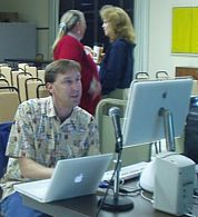 Harold gets his iMac set up before the show, with Anita and Pia in background. (Photo: Brian Carlin)