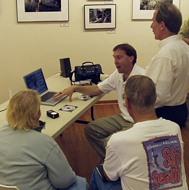 Harold Adams demonstrates iMovies, iDVD, iTunes, iPhoto, GarageBand.