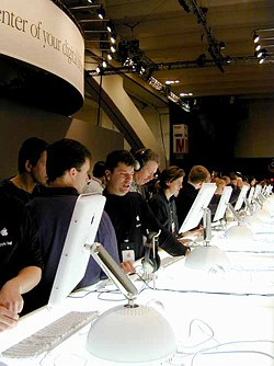 Visitors play with the new iMacs at Macworld Expo. (Photo: Pia Oliver)