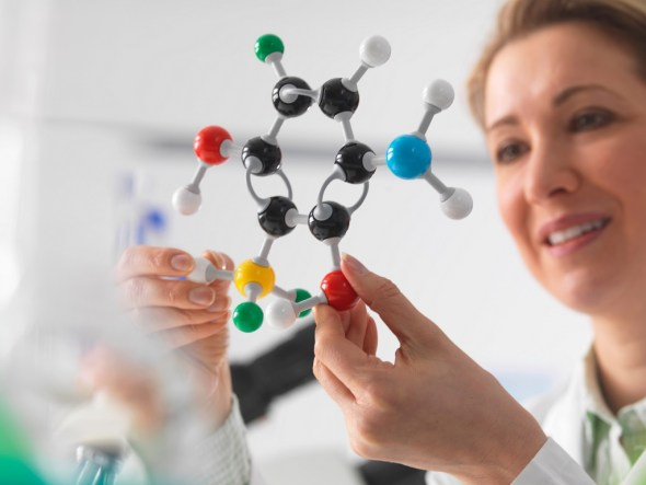 Scientist looking at molecular model