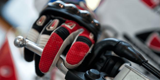 Rider glove on superbike handlebar