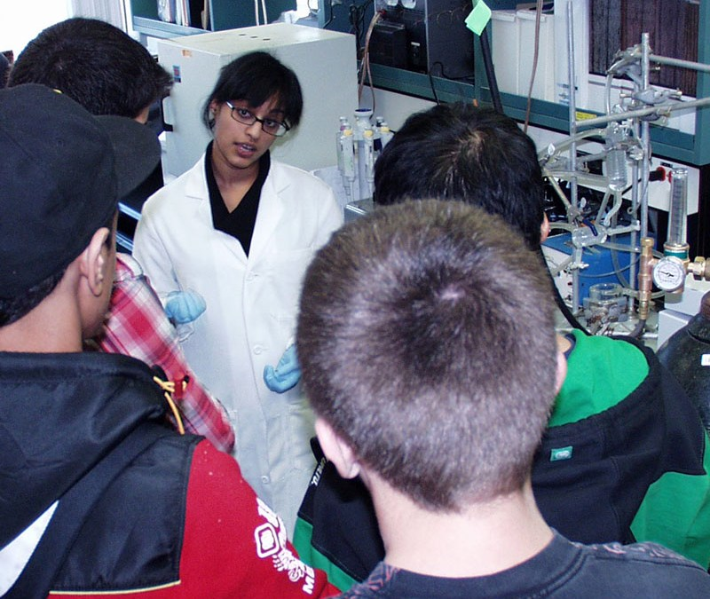 Riya speaks with students