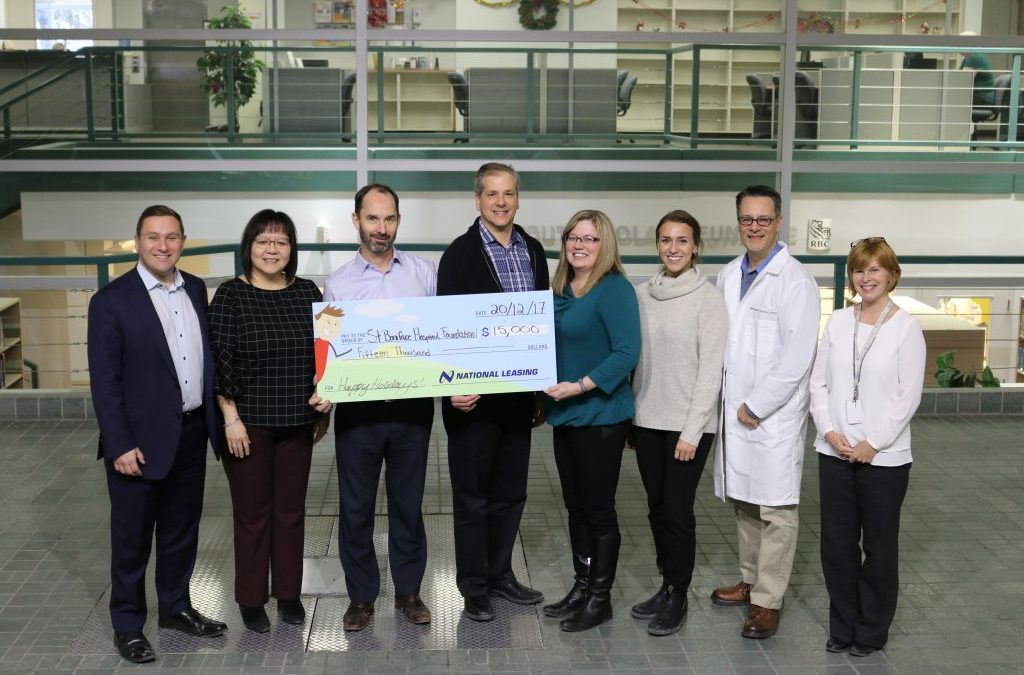 National Leasing presents cheque