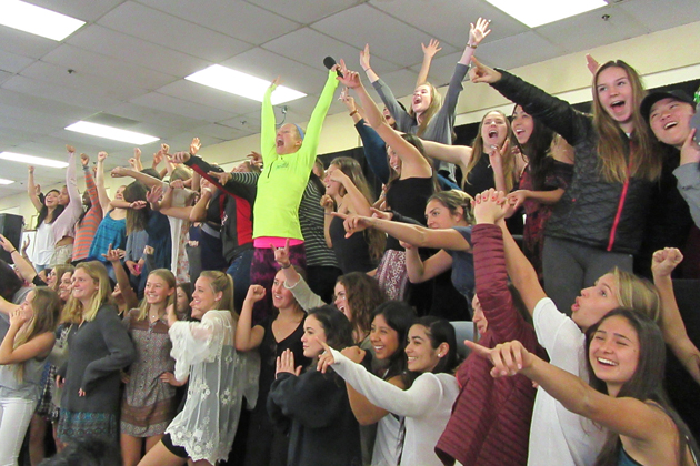 Fitness trainer Jenny Schatzle got the student-athletes to show their power pose.